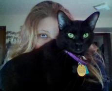 Jupiter and I earlier this year. He really enjoys interrupting my reading and writing time.