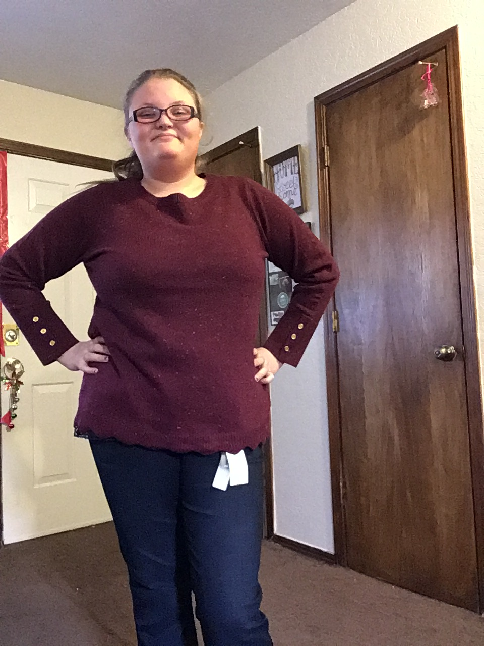 Me awkwardly posing to show off the jeans and sweater.